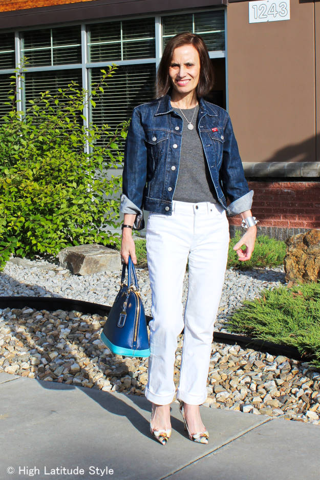 mature woman in white denim boyfriend jeans with blue denim jacket