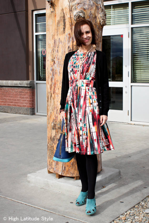 mature woman in summer dress styled for fall