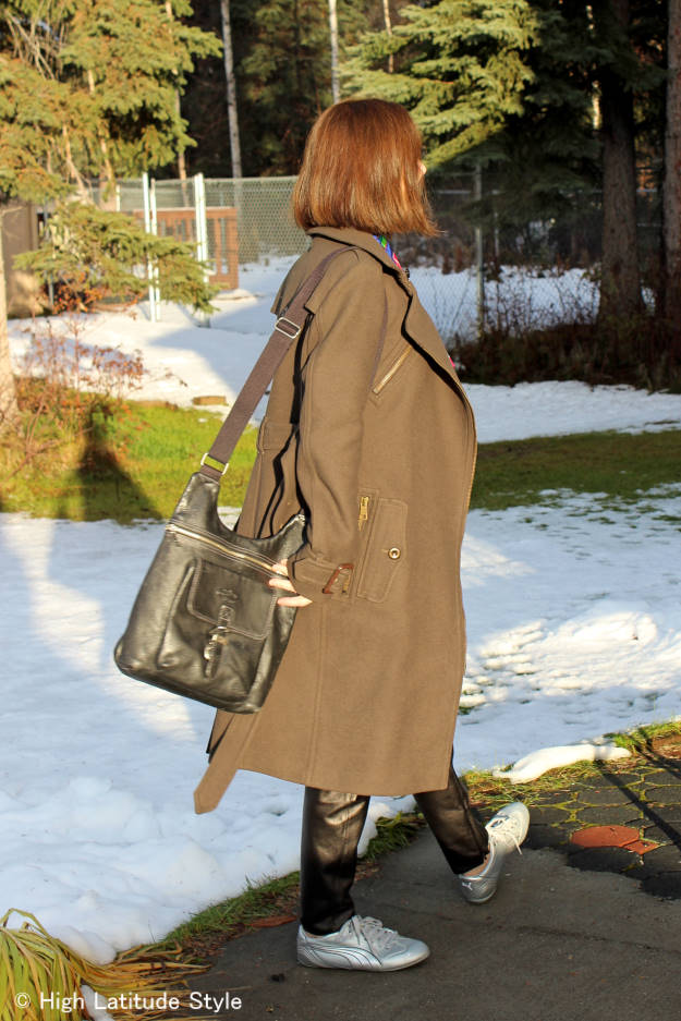 fashion over 40 woman in leather joggers and a motorcycle coat