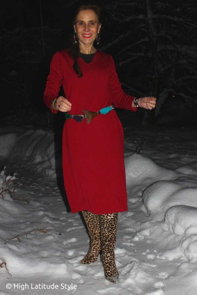 stylist in red knitdress for Thanksgiving with leopard boots, gemstone belt