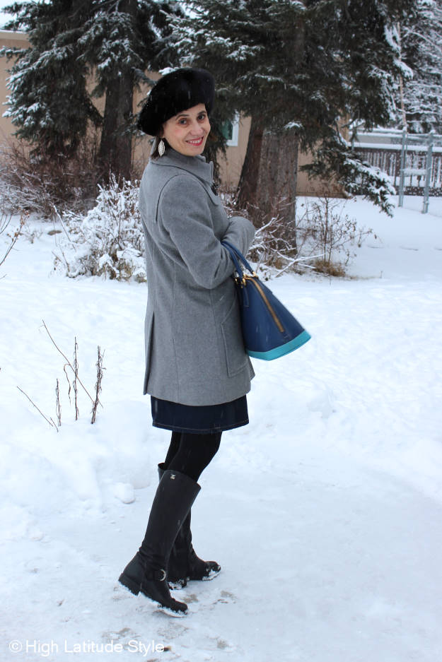 Alaskan fashion blogger in classic gray and blue work outfit with gray duffle coat