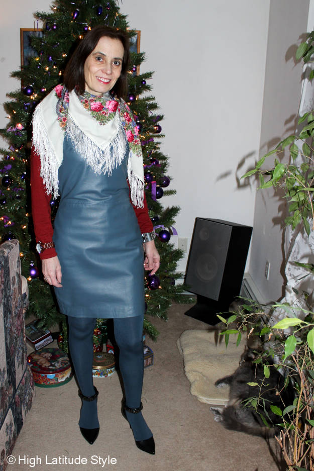 over 50 years old fashion blogger in a leather sheath dress styled feminine with a scarf