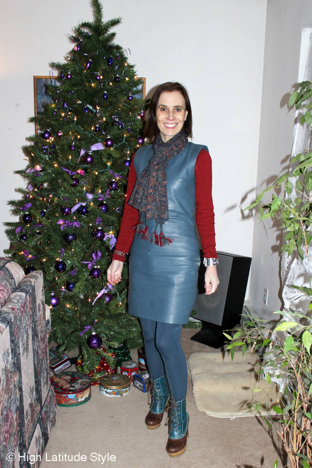 style blogger in leather sheath dress with an Indian block print scarf and statement duck boots