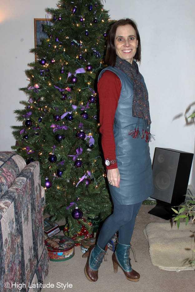midlife style book author in a fitted dress with ethnic scarf and heeled ducks