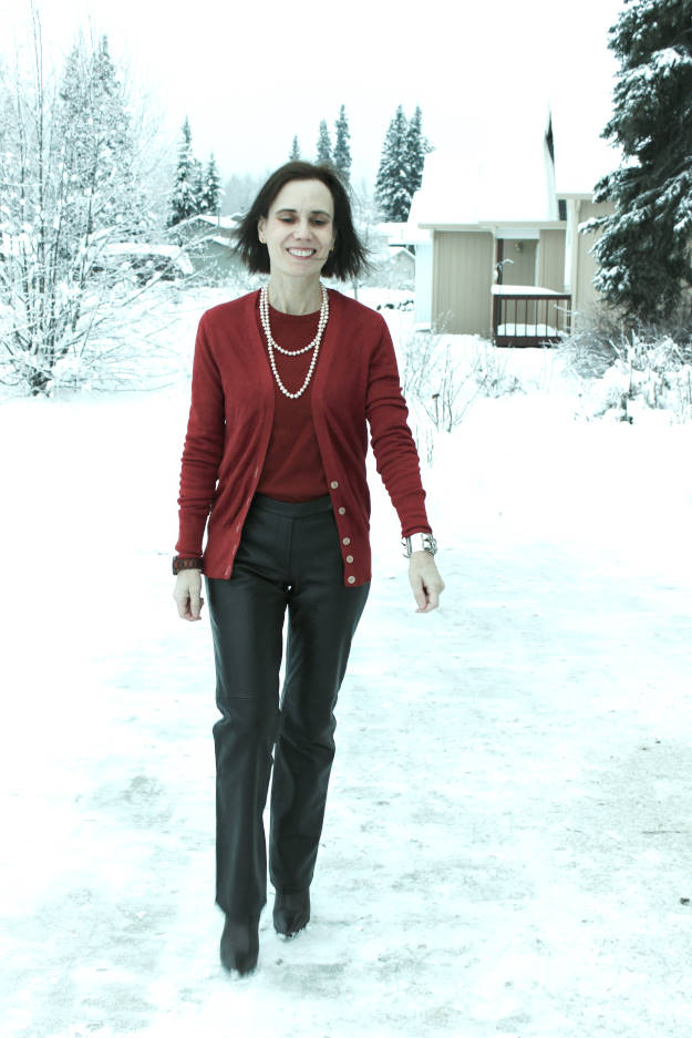midlife woman in winter work outfit with brown leather pants