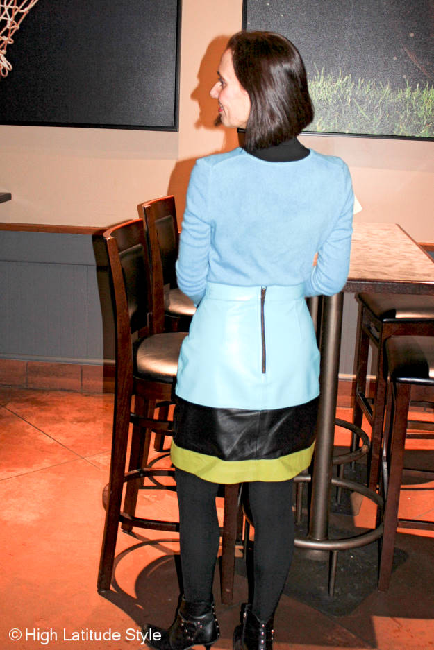 over 50 years old fashion bloger in colorful outfit with statement leather skirt