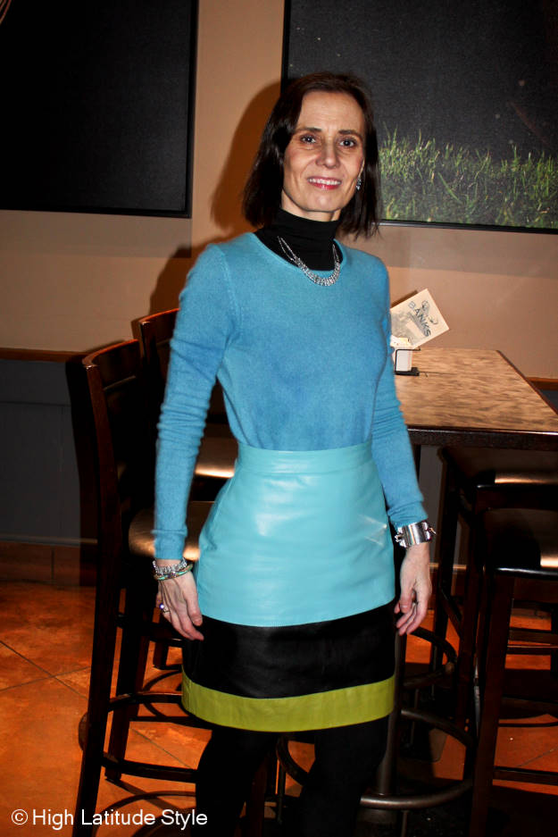 mature blogger in color blocked leather skirt