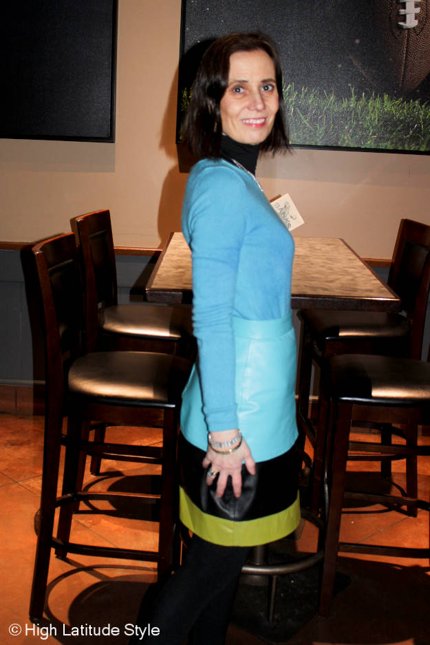 over 50 woman wearing turquoise for work