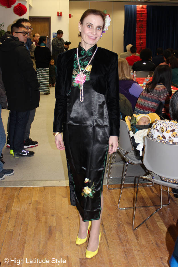 midlife woman in embroidered traditional dress for Chinese New Year's party