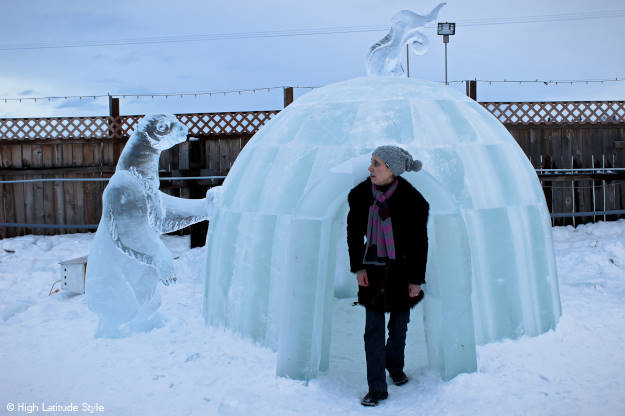 Alaskan woman in front of an igloo