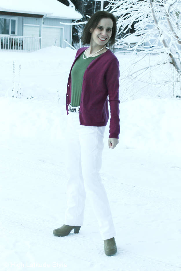 Nicole of High Latitude Style wearing an ONNO T-shirt with cardigan and white leather pants