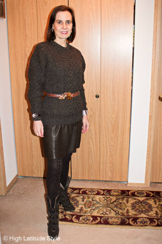 fashion blogger over 40 donning an Alaskan winter outfit with Irish cable-knit sweater
