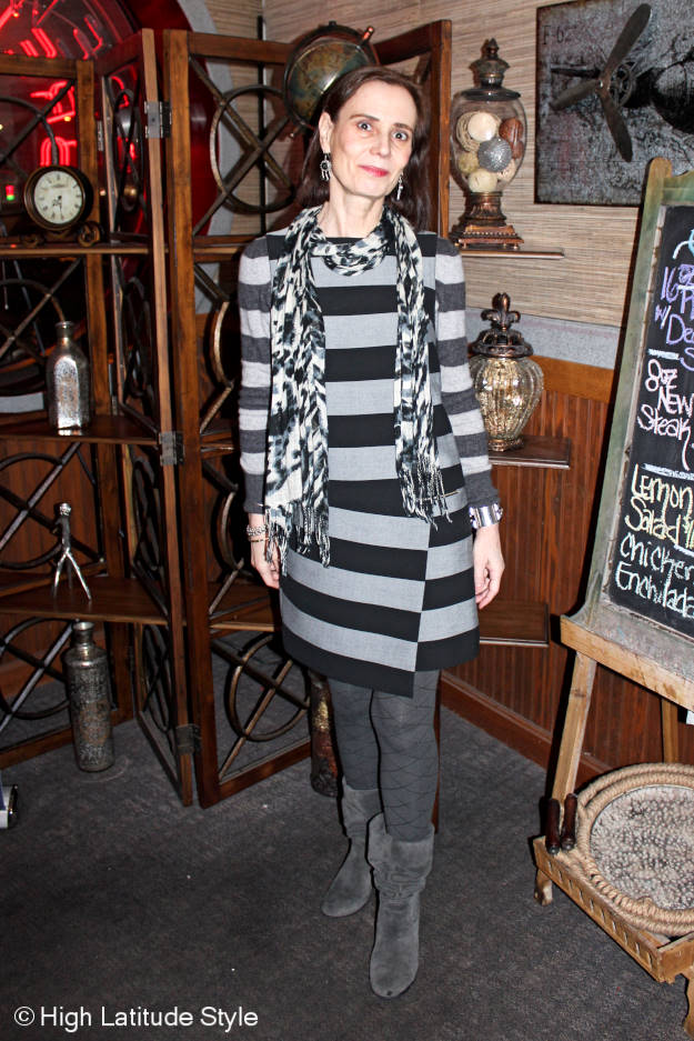 style blogger Nicole creating a long-sleeve dress look with a striped sweater and sheath