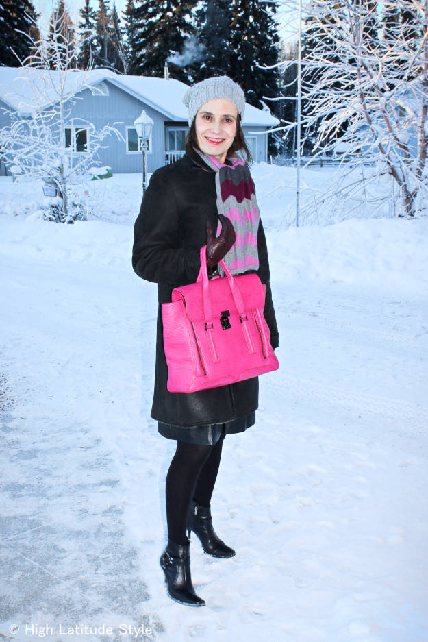 #fashionover40 style blogger Nicole in outerwear with a shearling coat, scarf, and pom pom hat