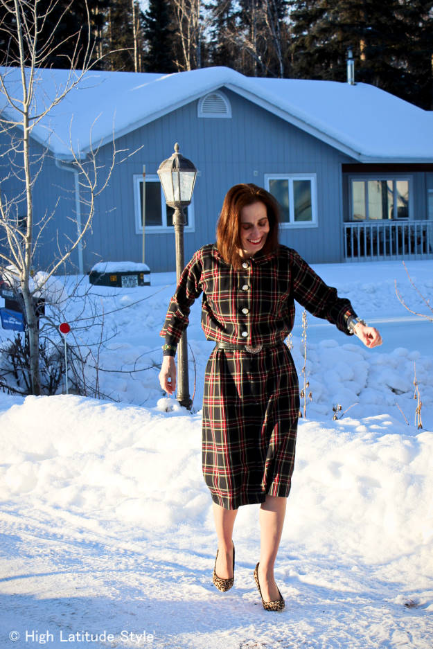 mature woman in plaid dress with leopard print pumps on snow