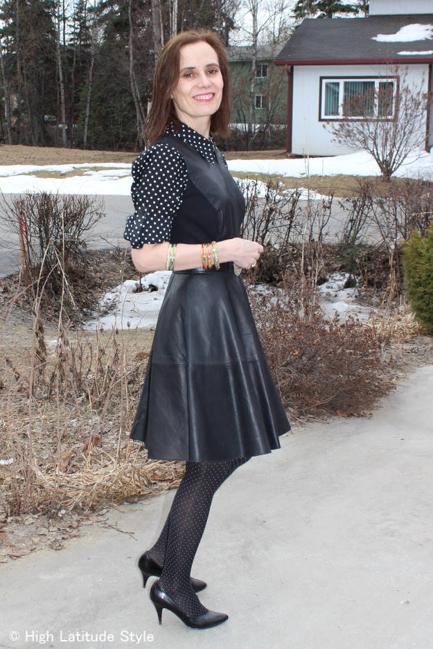 #styleover50 mixing pin and polka dots for a modern monochromatic look with a leather fit-and-flare dress