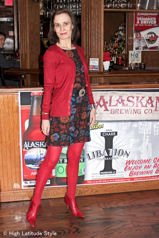 #fashionover50 Alaskan woman wearing a posh casual floral sheath with cardigan