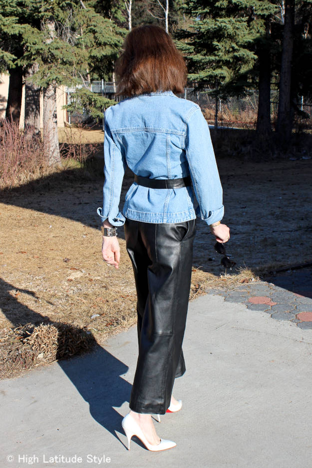 older woman in leather cullottes