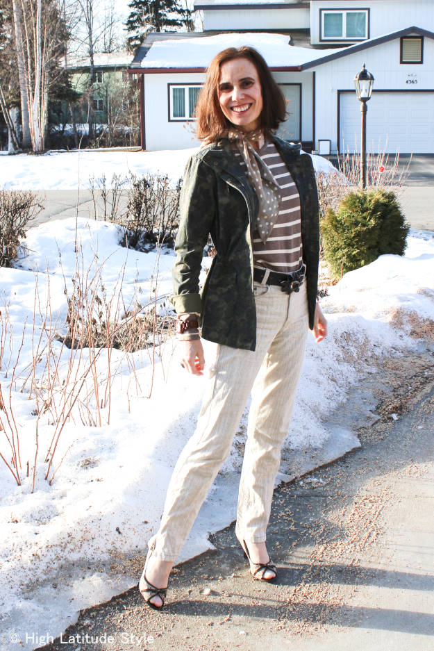 #fashionover50mature woman in Alaska casual spring outfit with utility jacket