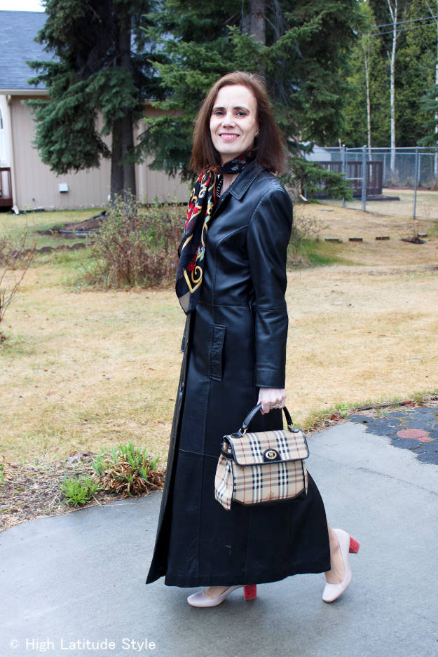 midlife style blogger in long leather coat