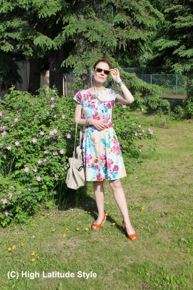 Style blogger in floral fit-and-flare dress