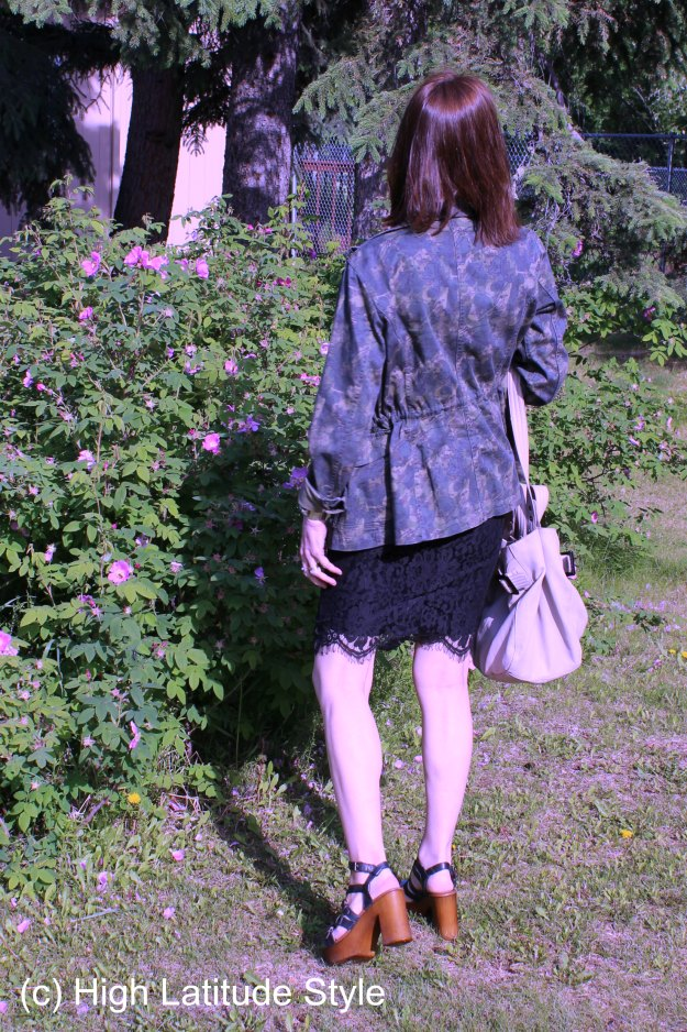 Back view of outfit with jacket, skirt, Tote, and wood plateau sandals