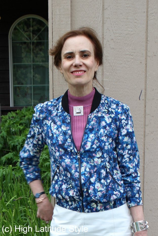 styling a floral bomber for a mature look using a pin instead of a necklace