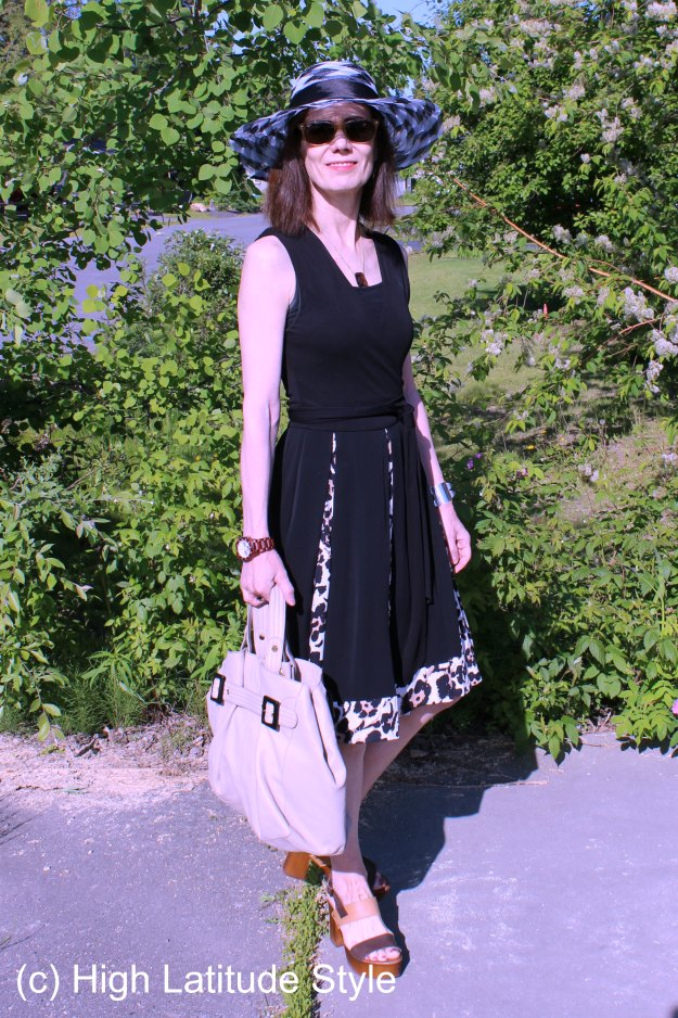 #midlifestyle woman in wrap dress with hat