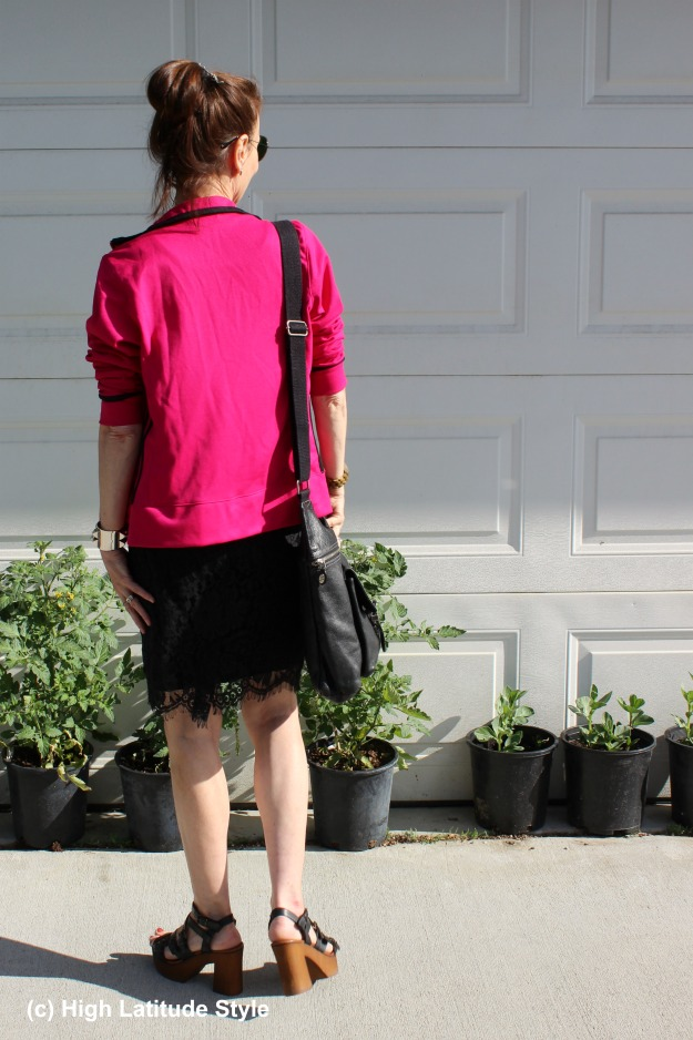 style over 50 woman with Adidas jacket and lace skirt