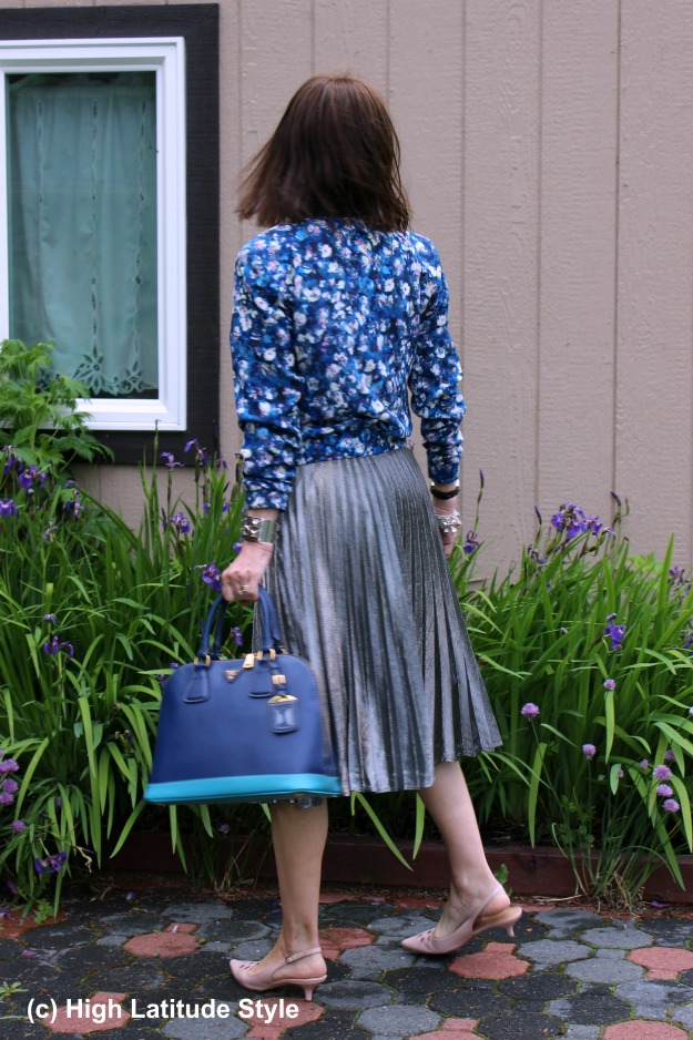 #fashionover50 mature woman in bomber jacket and skirt