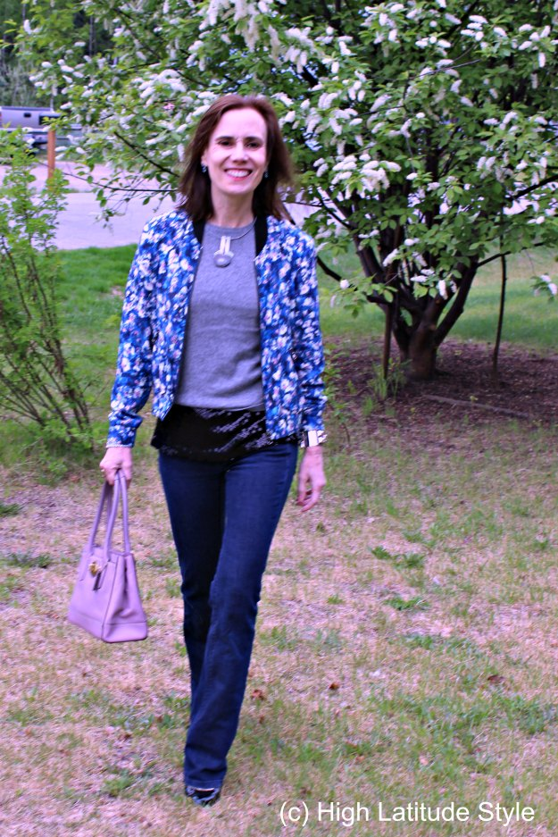 #fashionover40 mature blogger in June outfit of the month with foral bomber with flared jeans