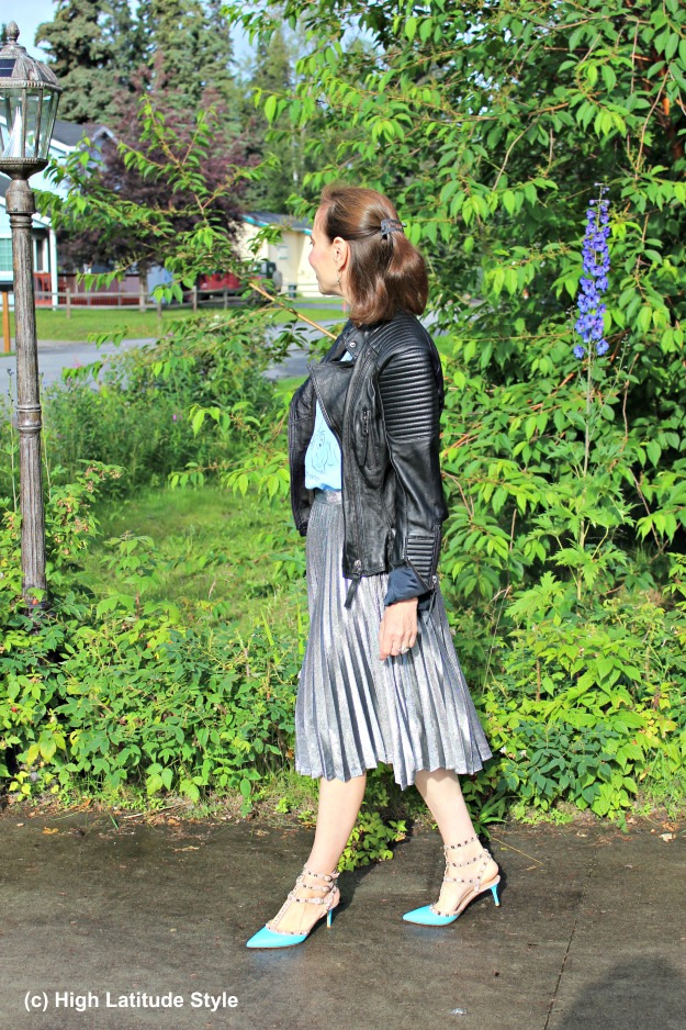 stylist in street chic silver skirt leather jacket