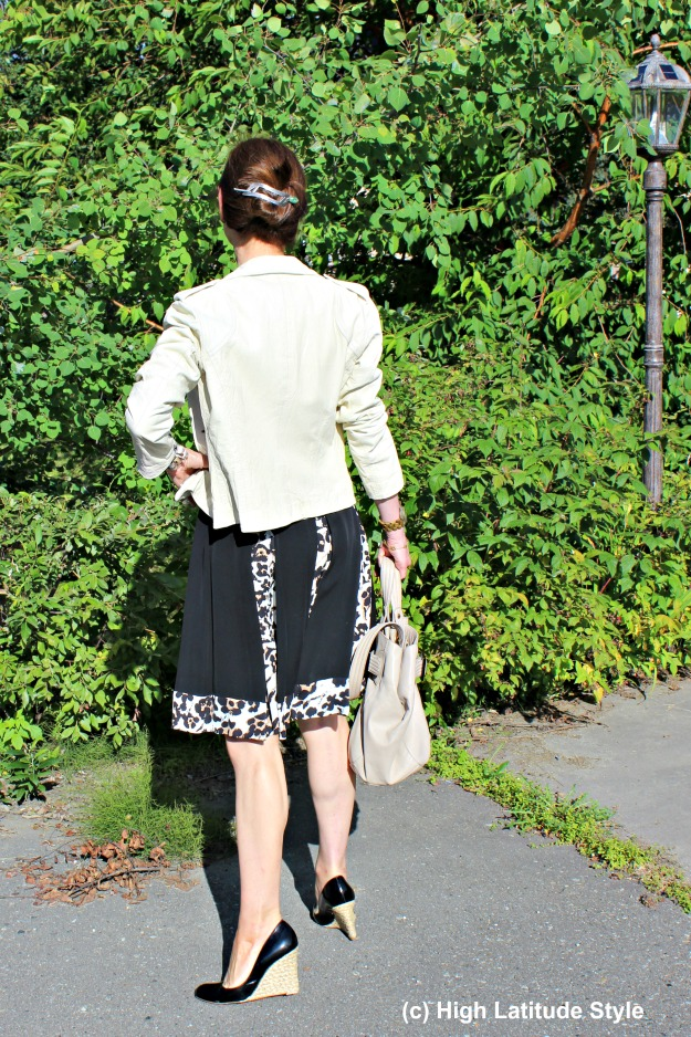 back view of DvF dress and leather jacket