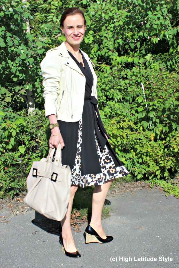 #fashionover40 mature woman wearing an instant outfit of wrap dress with motorcycle jacket