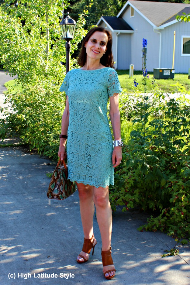 mature lady in modest pastel lace sheath dress