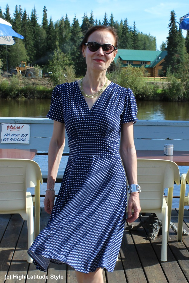 over 50 years old woman in blue and white polka dot dress