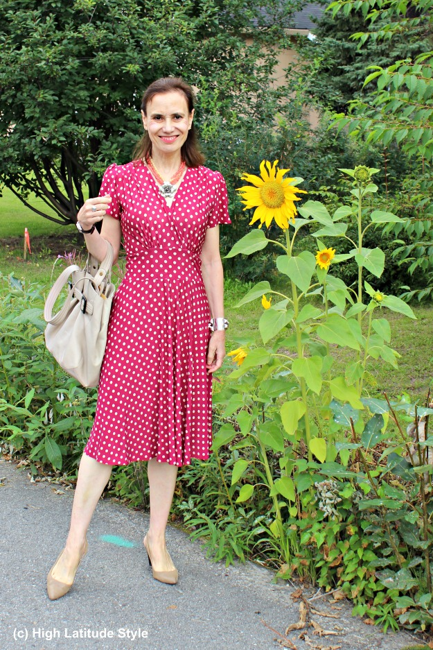 #fashionover50 mature woman in a red polka dot dress