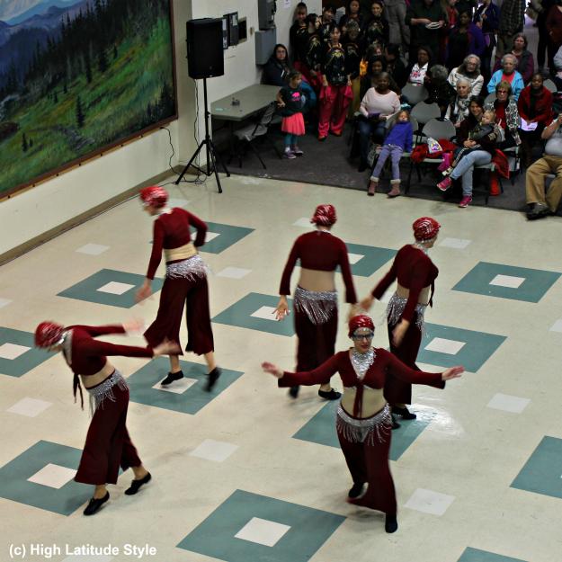women performing belly dance