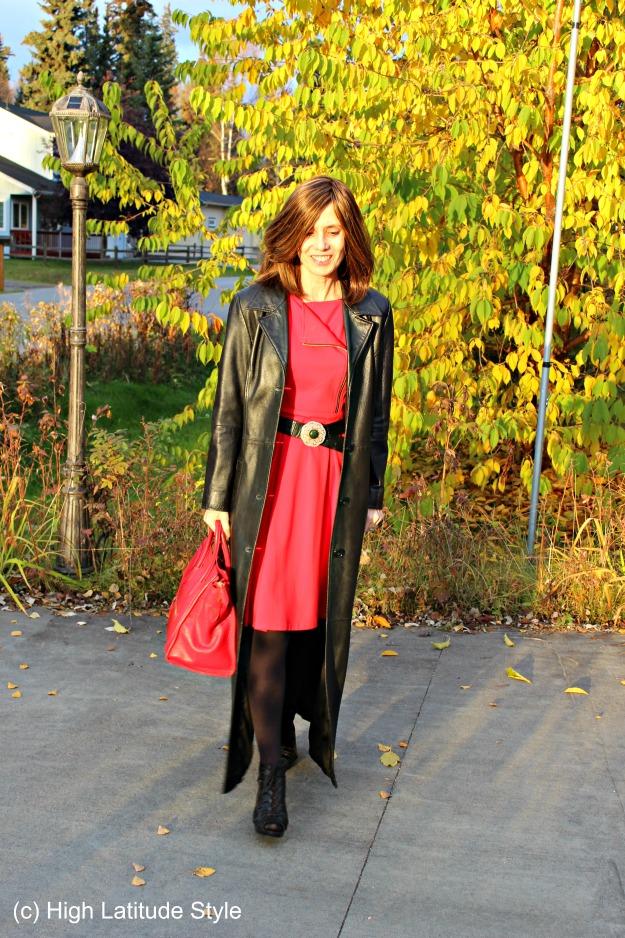 mature woman in posh long black leather coat