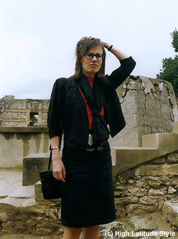 young woman in fake black suits in the early 90s