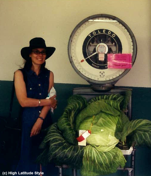 blogger side-by-side with the largest cabbage grown at the Last Frontier