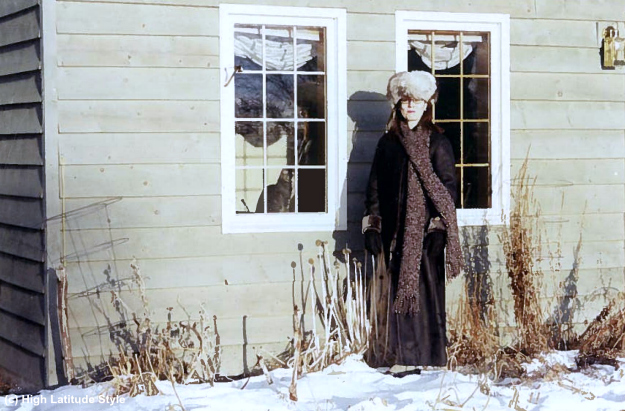 style over 40 woman in long winter coat with hat and long scarf in Alaska