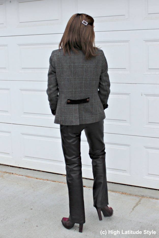 style blogger donning straight leather pants and an Irish blazer for a posh office look