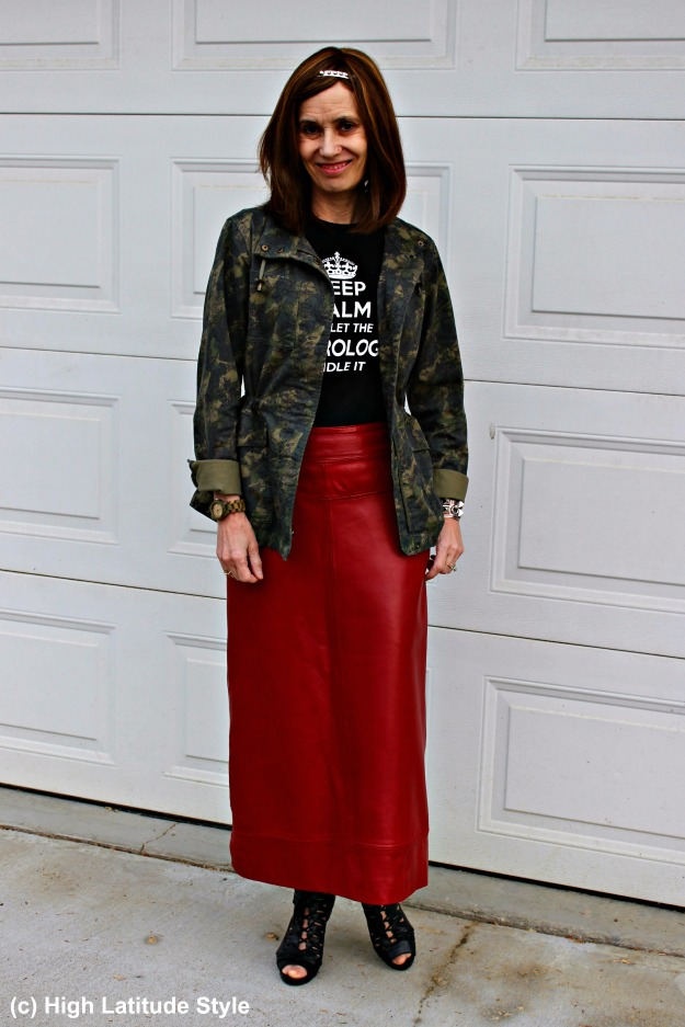 mature style woman in casual look with leather skirt