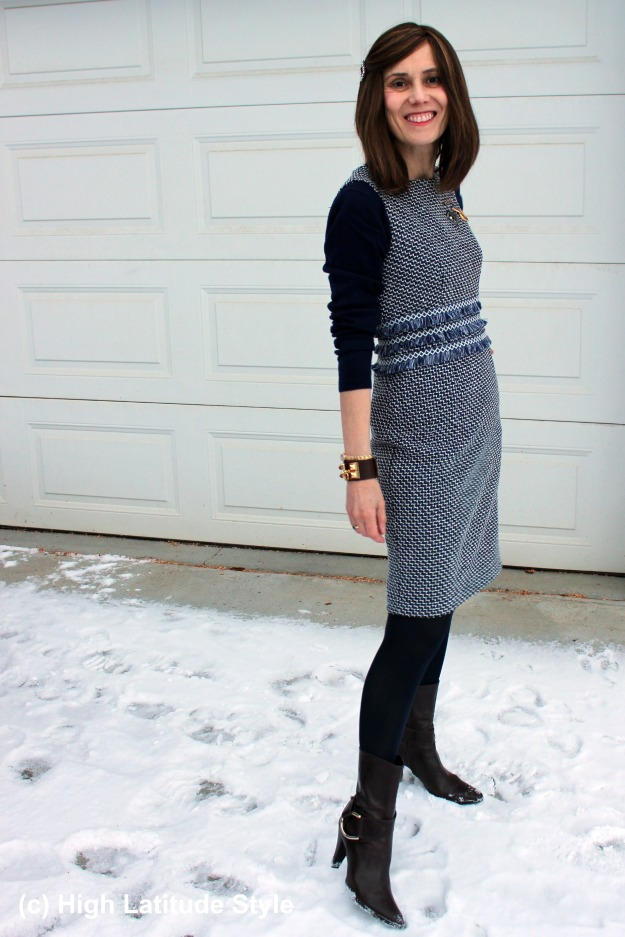 #midlifefashion woman wearing a chic sheath dress with sweater