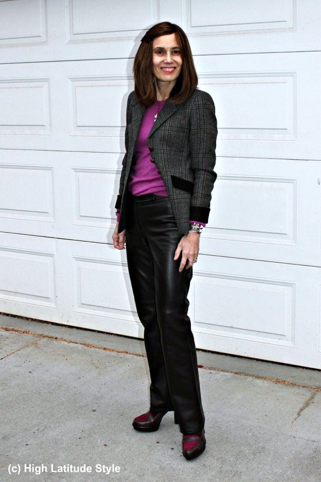 fashion blogger in business casual outfit looking chic in straight brown trousers