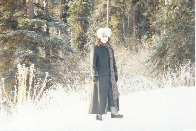 Alaskan woman standing in the yard in Alaska