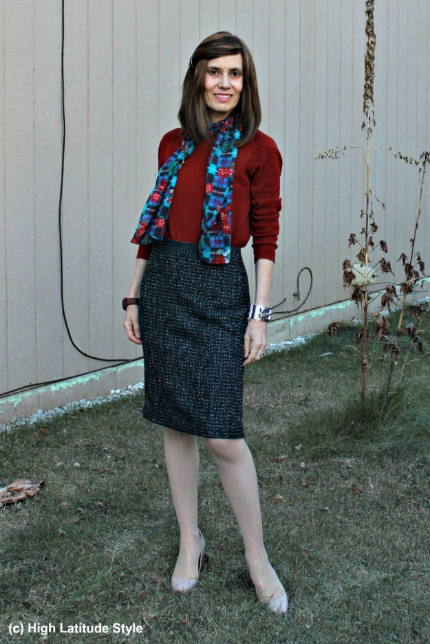 maturestyle woman in work outfit with tweed skirt, sweater and scarf