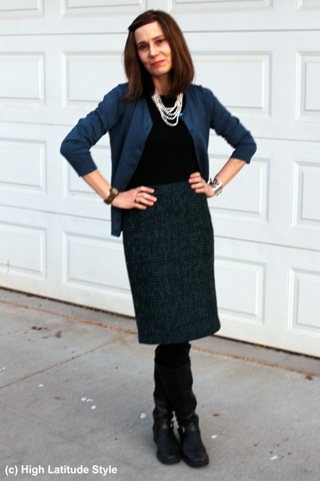 stylist in fake twinset and tweed skirt