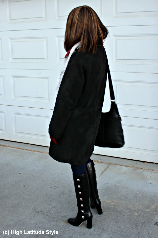 #winterstyle midlife woman in winter outerwear with studded boots